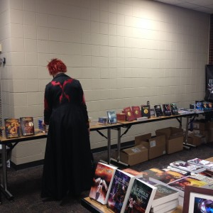 A character from Tsubasa Reservoir Chronicle browsing the bookstore.